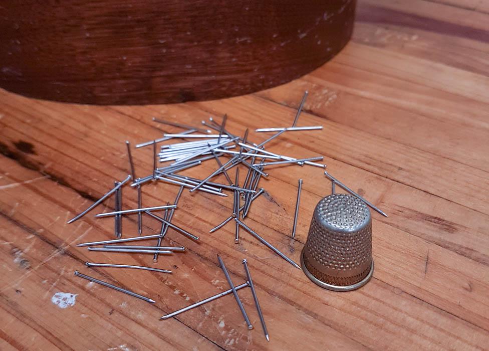 Blocking pins and a metal thimble