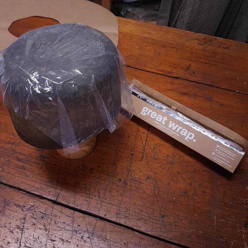 Greap wrap plastic film on hat block